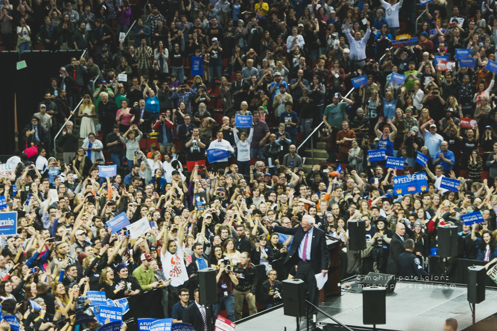 senator bernie sanders waves the crowd goodbye at the end of the seattle rally at key arena, seattle center