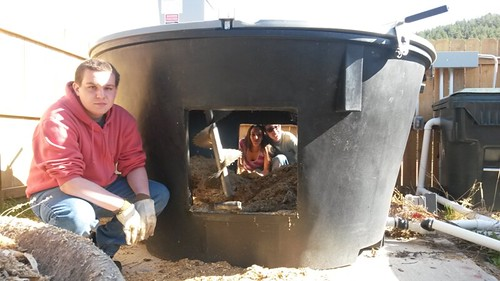Boxelder math students Jacob Zulauf, Shaylee Habtemariam, and Conner Mylander working in the Earth Tub compost system