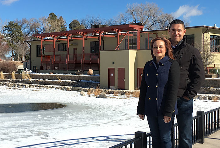 NAVAF winners Melissa Blueflower-Sanchez and Robert Sanchez from R & M Construction in front of the Los Alamos Teen Center their company recently helped remodel.