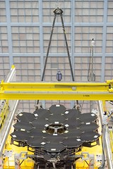 In this rare view, the James Webb Space Telescope´s 18 mirrors are seen fully installed on the James Webb Space Telescope structure at NASA´s Goddard Space Flight Center in Greenbelt, Maryland. Credits: NASA/Chris Gunn
