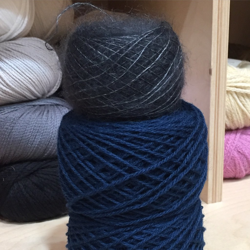 a yarn cake stack for my newest project. featuring a ball of shibui silk cloud and a ball of isager jensen