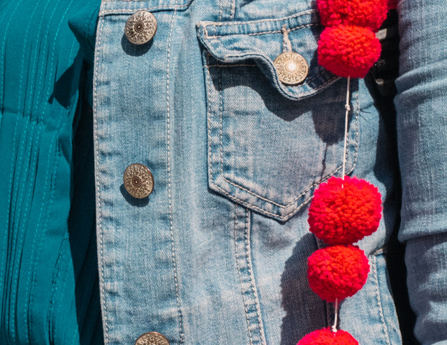 pom poms on denim jacket