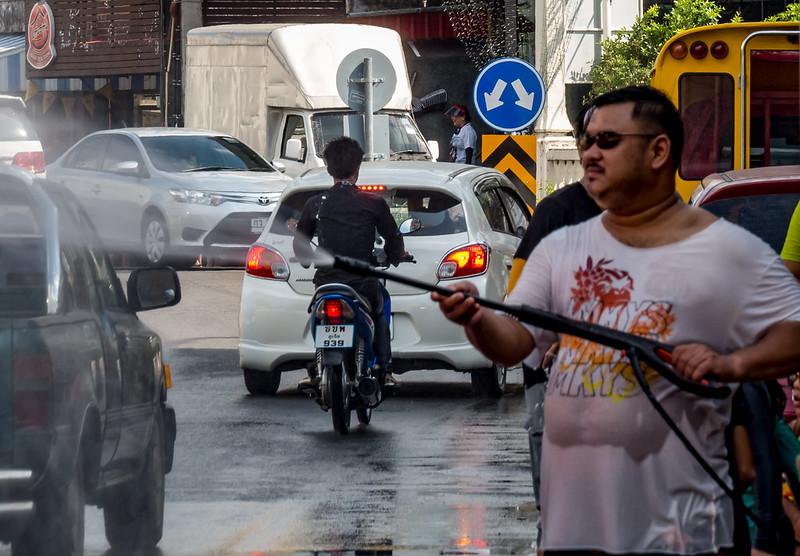 man using pressure washer during songkran water festival 2016 in Phuket, Thailand