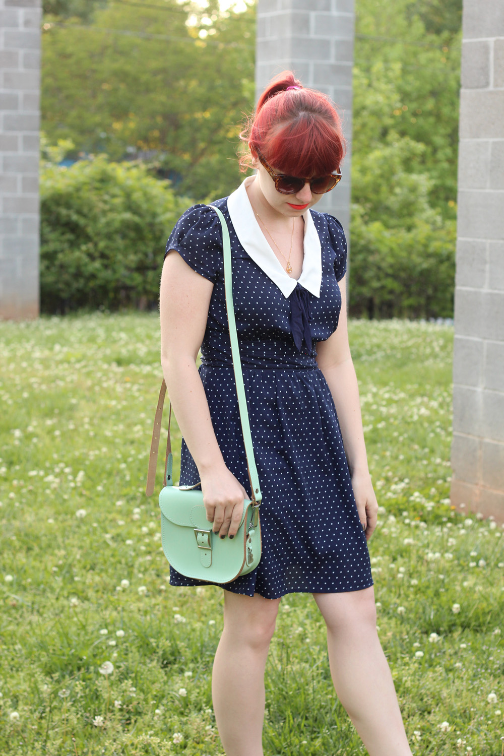 Mint Green Brit-Stitch Satchel, Navy Blue Polka Dot Dress with White Collar, Bright Red Hair