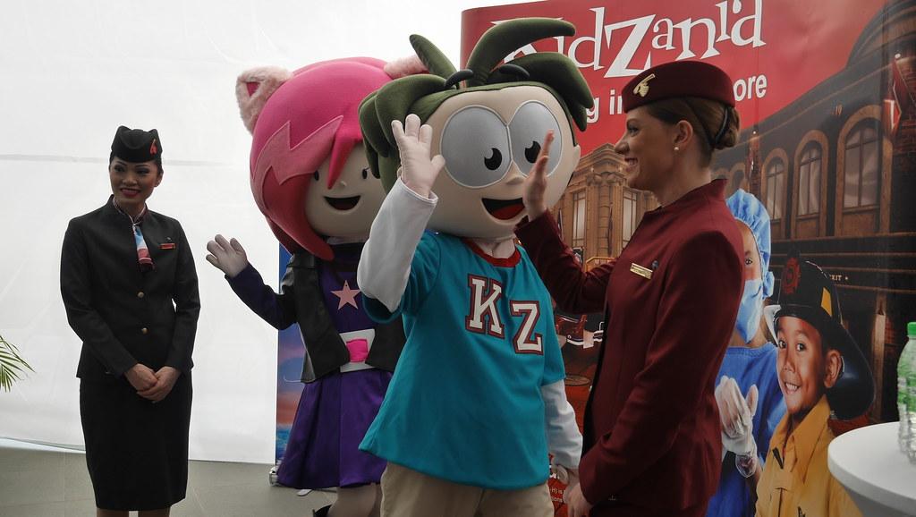 Qatar Airways' cabin crew high-fiving the KidZania mascots