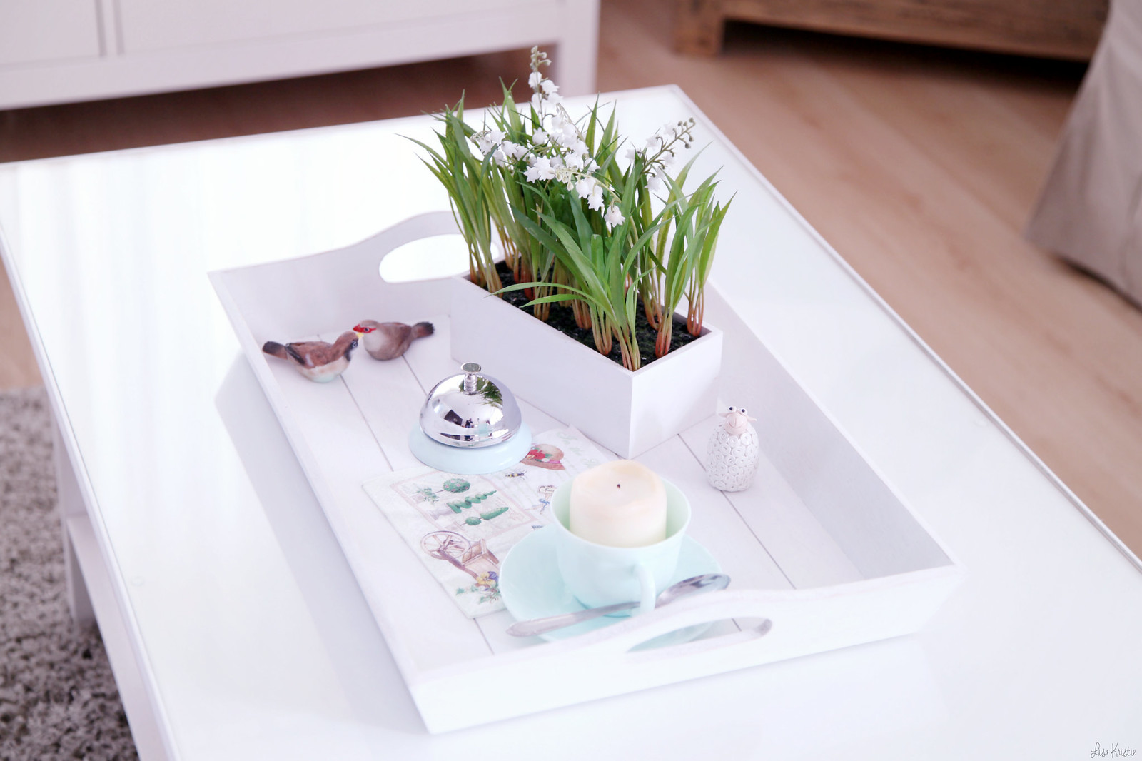 Spring decoration tray coffee table living room interior home house wooden white teacup fake flowers lily of the valley lilly pale pastel shabby chic european birds sheep candle in cup spoon