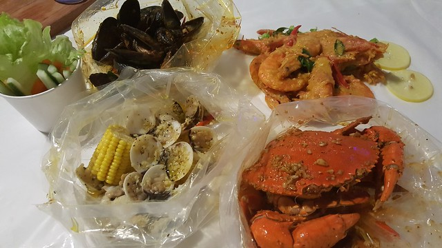 Our seafood order - Mussels, Clams, Prawns and Sri Lanka Crab, each in a different sauce.