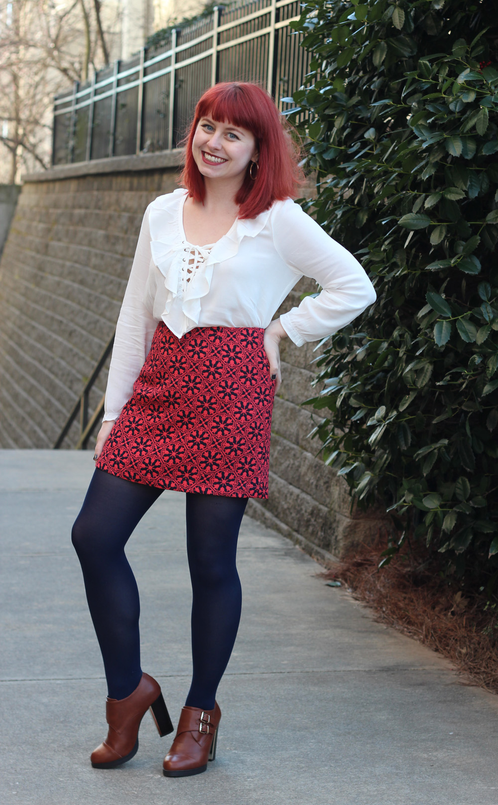 Quatrefoil Floral Print Mini Skirt, White Ruffled and Lace Up Blouse, Navy Blue Tights, and Retro Inspired Tawny Brown Block Heel Boots