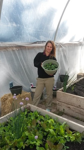 Boxelder student Celina Wagner showing off the vegetables and flowers