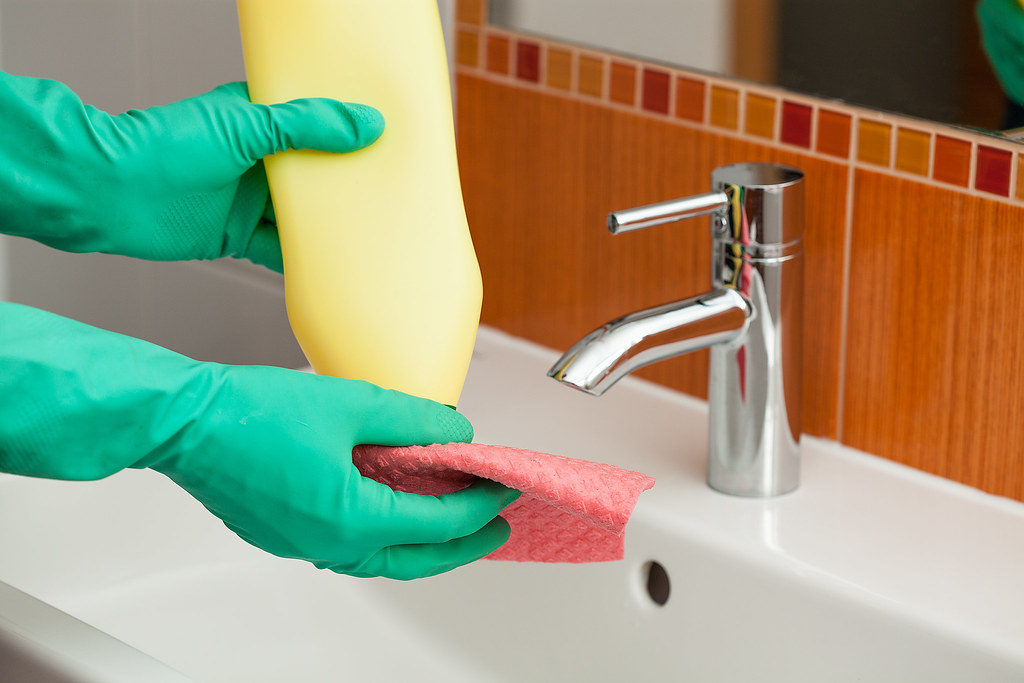 Bathroom cleaning a man cleaning a bathroom using a rag for 9 bathroom cleaning problems solved
