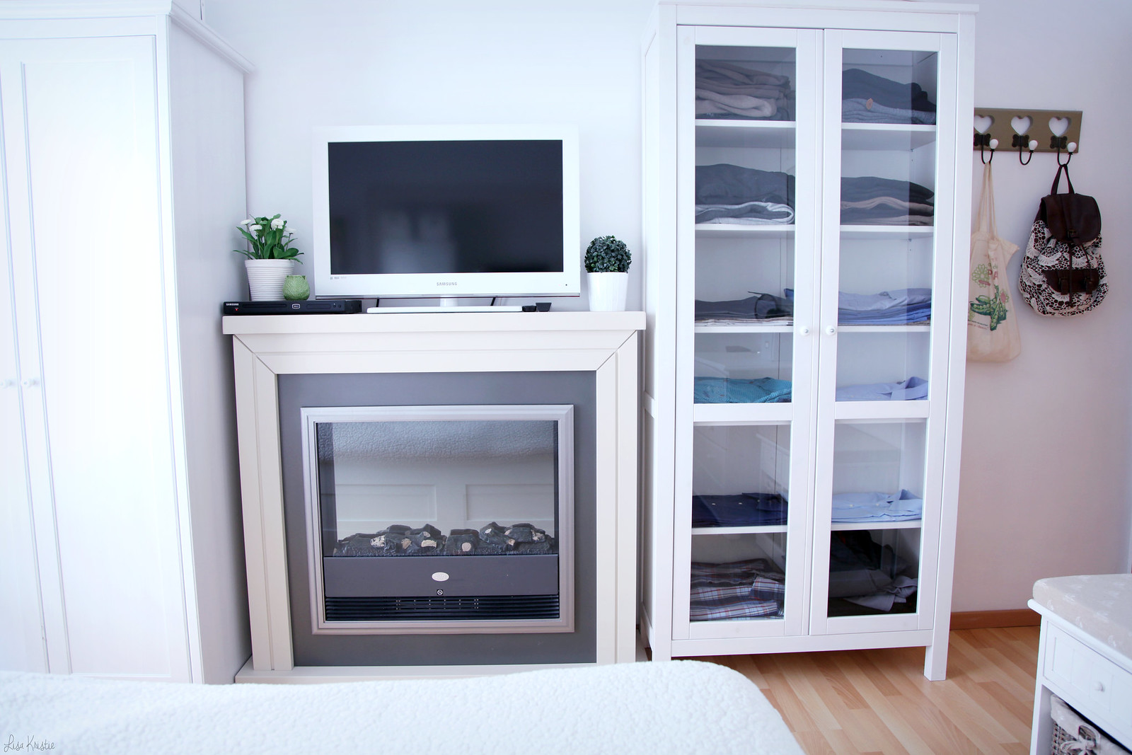 bedroom interior home white pale colors scandinavian style minimalistic clean fireplace flatscreen tv ikea wardrobe furniture hemnes glass doors cabinet decoration