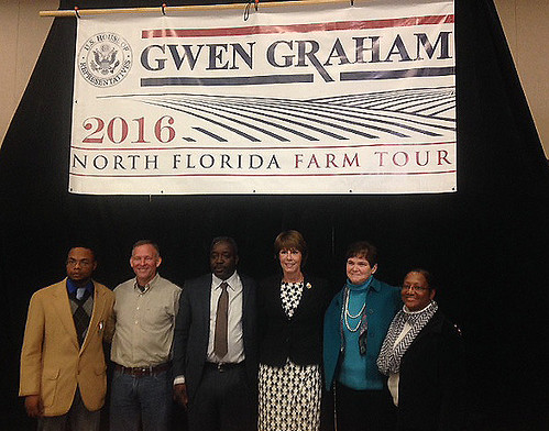 USDA Deputy Secretary Krysta Harden and Congresswoman Gwen Graham standing with others at the 2016 North Florida Farm Tour