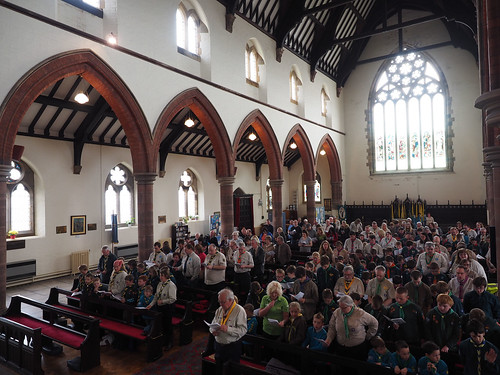 Photo inside St James packed with Scouting members and leaders.