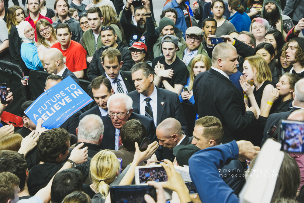 senator bernie sanders listening keenly to a supporter at the seattle rally at key arena, seattle center