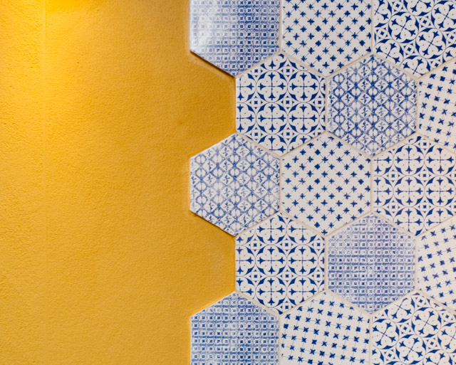 tiles on yellow wall