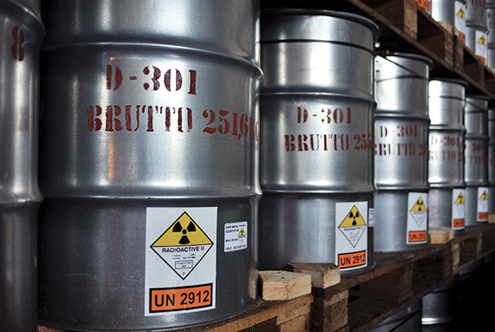 Rows of cans marked radioactive on a storage shelf