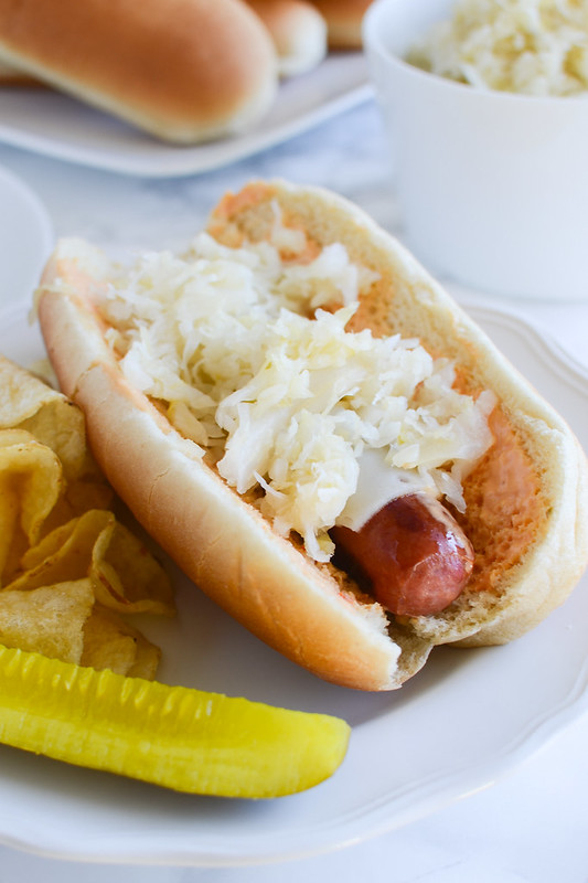 Reuben Brats - so perfect for football season! Grilled brats topped with thousand island, swiss cheese, and sauerkraut!