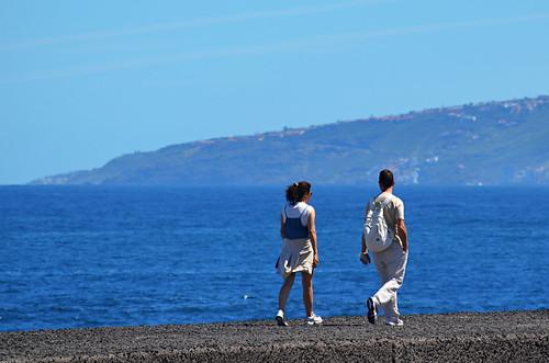 Walking along the sea wall, Puerto de la Cruz, Tenerife