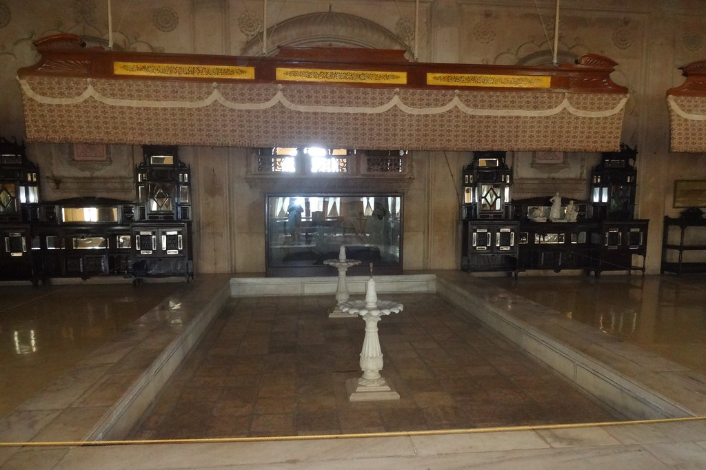 The old fan which the servants would run manually, stands just above the two fountains. This arrangement can be equated with a modern-day water cooler that provides moisture and humidity in dry places.