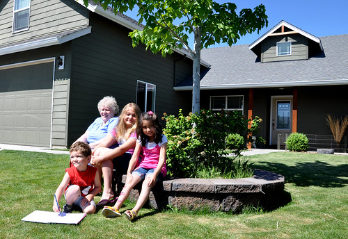 The Waddington Family outside their new home in Oregon
