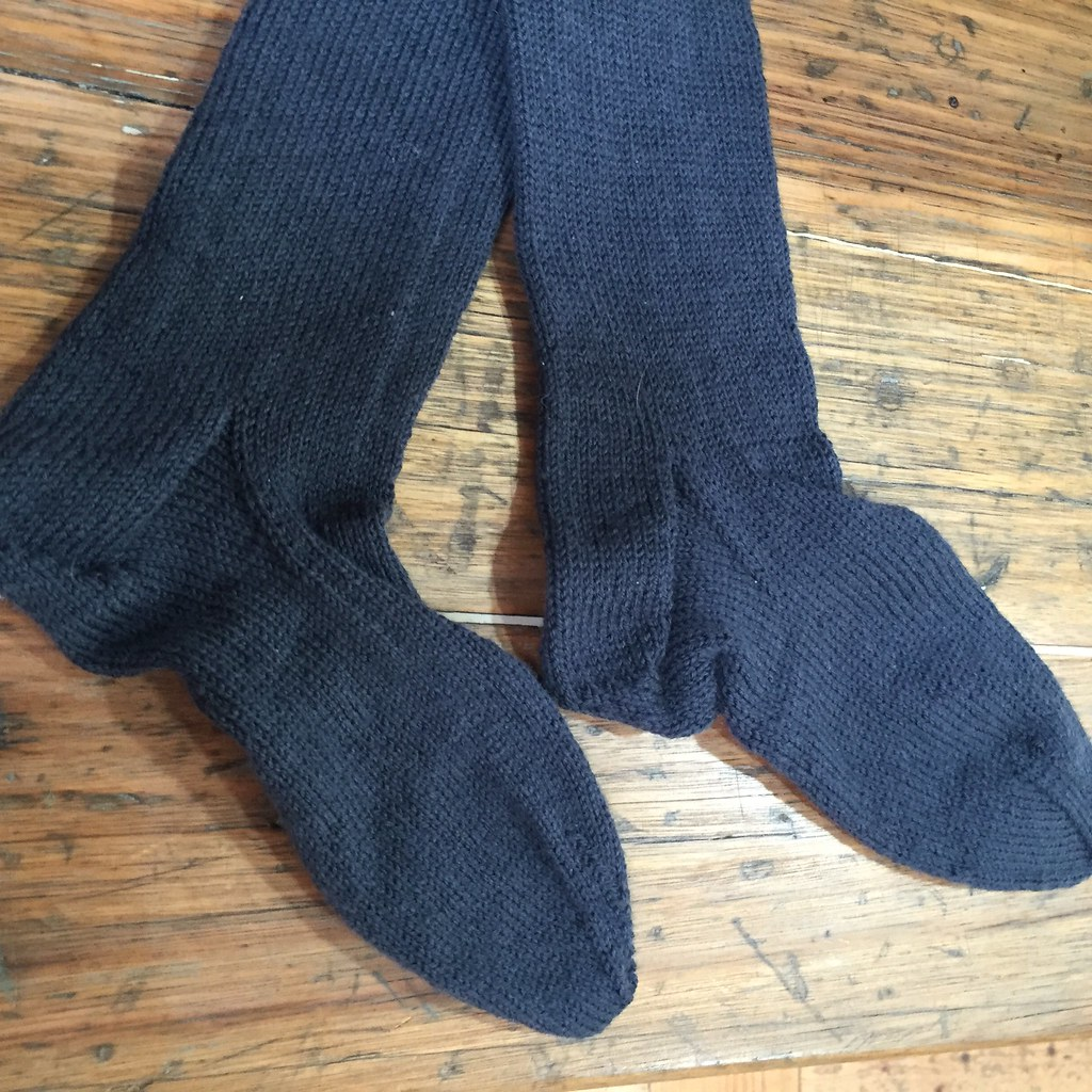 a pair of socks knit in grey patonyle for my great uncle frank