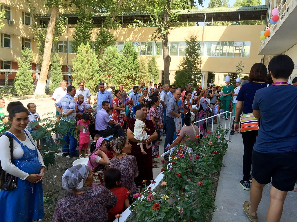 Fergana, Uzbekistan, Aug 2015: A crowd has gathered outside the Fergana Multi-field Paediatric Institute, eagerly waiting for the screening results to be announced at the end of the first day of the mission. Only suitable candidates will be able to undergo surgery. Credit: Florence Ng