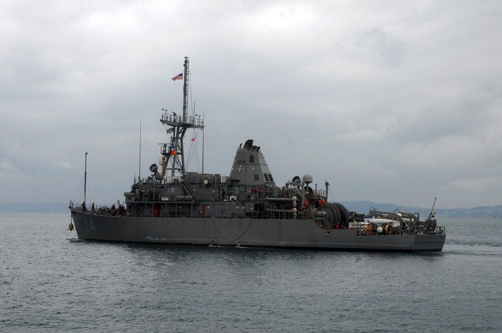 160311-N-MP556-035 Okinawa, JAPAN (Mar. 11, 2016) Mine countermeasure ship USS Chief (MCM 14) departs White Beach Naval Facility to join up with USS Patriot (MCM 7) as they prepare to conduct squadron level mine countermeasure training which includes mine hunting and mine sweeping.