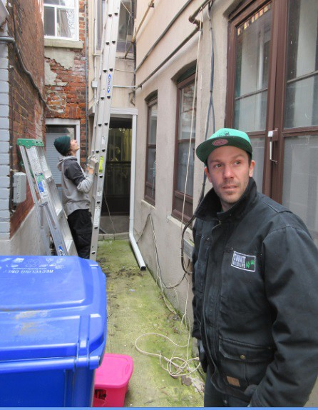 Derick in the alley after raccoon capture