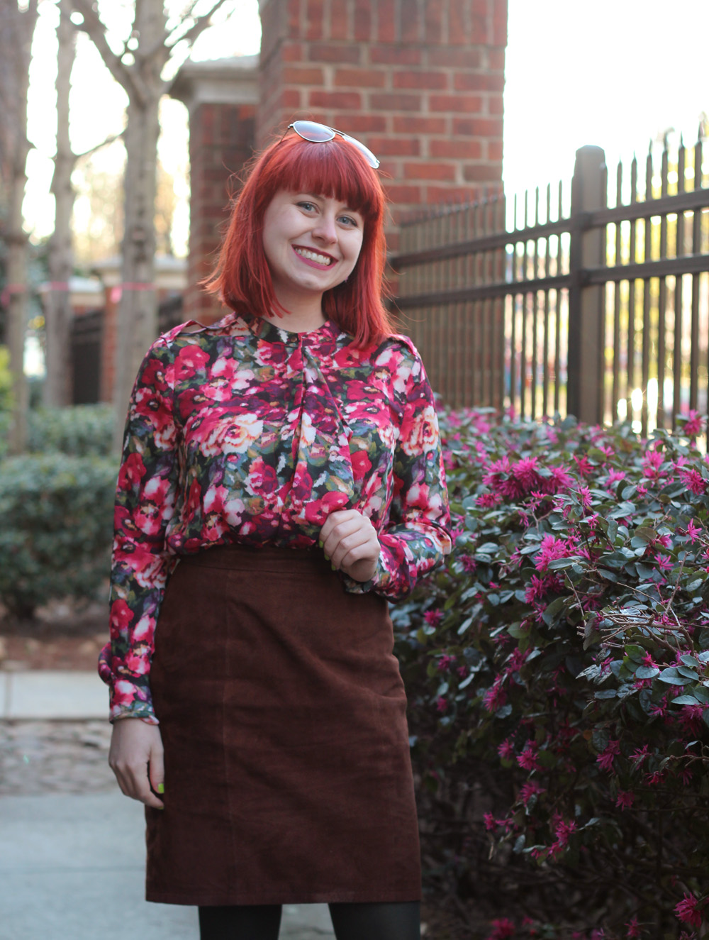 Ruffled Floral Long Sleeved Blouse, Bright Red Hair, and a Brown Suede Pencil Skirt