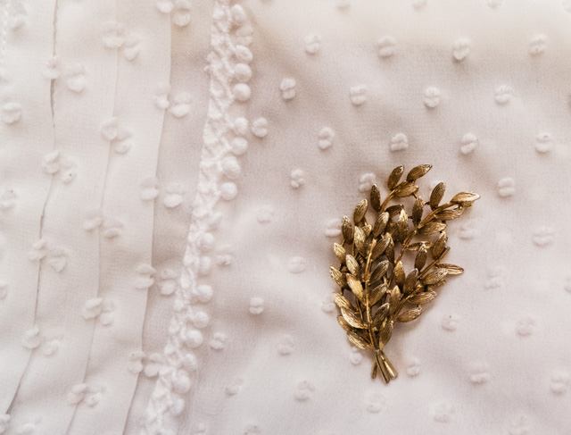 gold tone brooch on laura ashley blouse