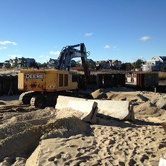 This excavator is preparing the site for the installation of the steel sheeting, wooden pilings, and the new culvert. Construction will start on the pond end of the culvert and end on the oceanside. Credit: Katie Conrad/USFWS