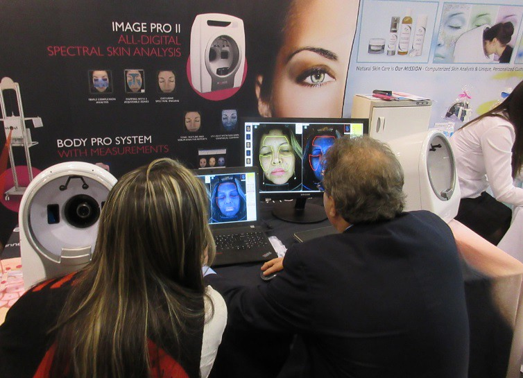 Lonnie Wallace inspects skin analysis results of Image Pro II