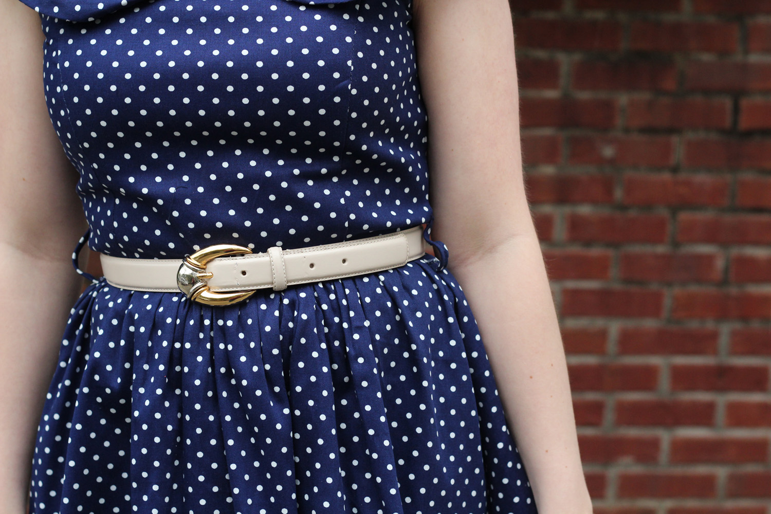 Navy Blue Polka Dot Lindy Bop Dress with an Off White Mixed Metal Belt