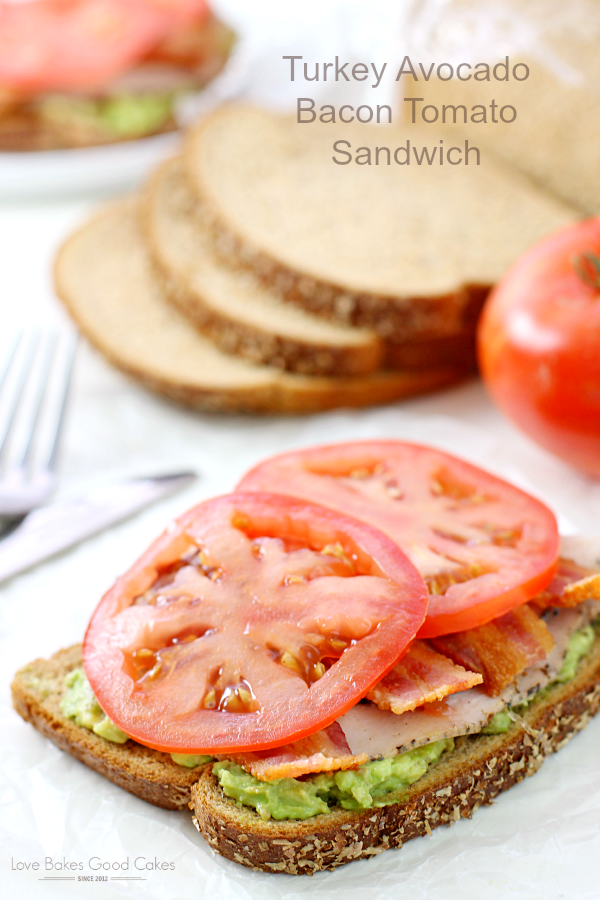 Turkey Avocado Bacon Tomato Sandwich on a plate.