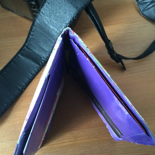 A duct tape wallet turned upside down to show where it's splitting at seams.