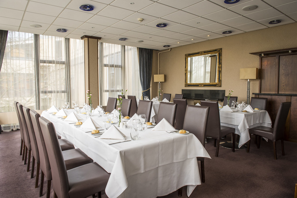 Tables laid for service in Wessex Restaurant