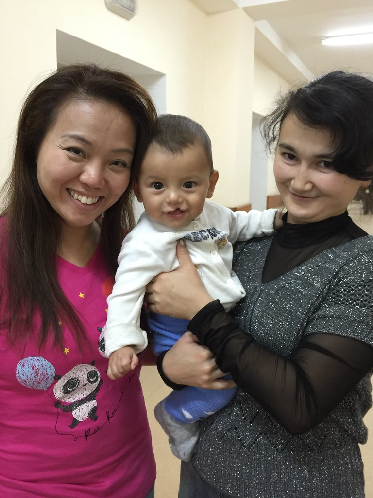 Cute as a button: The Smile Mission volunteer Florence Ng with a months-old patient she nicknamed