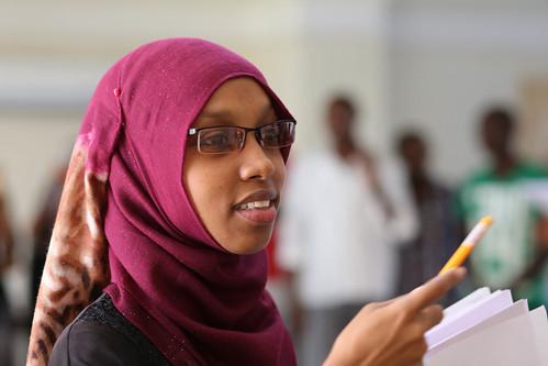 An image of a workshop participant explaining an idea