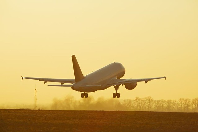 aeroplane-taking-off-at-sunset