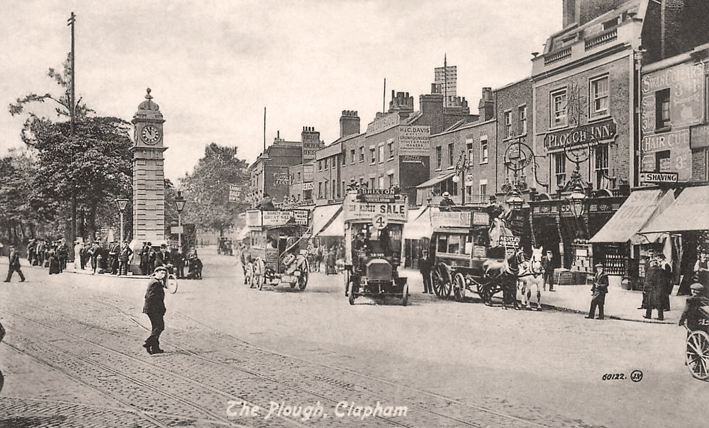 The clock tower and the Plough Inn at Clapham Common, London, 1895.