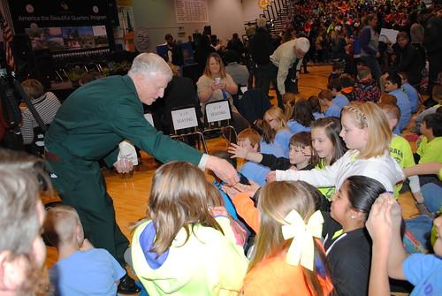 Forest Service Chief Tom Tidwell handing children new Shawnee Quarter