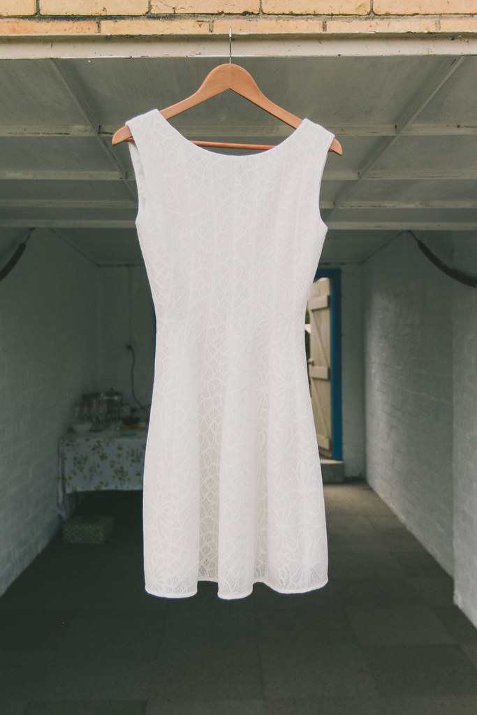 white alannah hill dress hanging on garage door