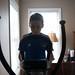 boy on elliptical machine 01-750