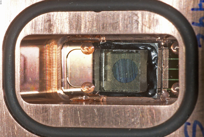 Plutonium alpha phase metal samples are mirror finished 6mmx6mm squares 250 micrometers thick, sandwiched between platinum sample holders and transparent lithium-fluorite windows, and mounted in Z target copper panels. The target assemblies are made at Los Alamos National Laboratory.