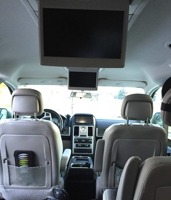 our minivan has a double dvd player 2 pop down screens as well as a 3rd screen up by the driver that only shows the movie when the vehicle is in park