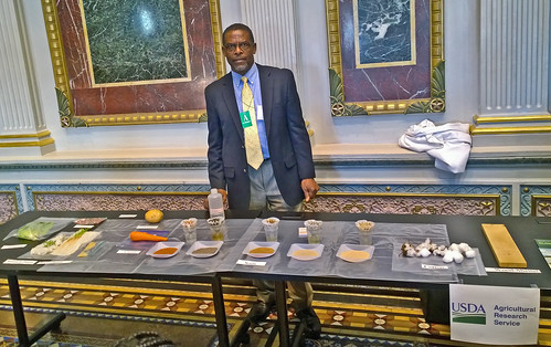 Agronomist Eton Codling, ARS Crop Systems and Global Change Lab with different types of soil at White House Day at the Lab