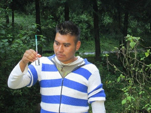 A program participant measuring levels of dissolved oxygen in the water in the Francisco Serrato Community, Michoacan, Mexico