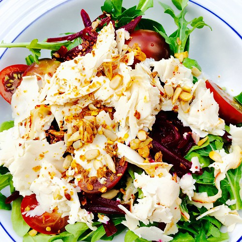 Turkey salad with tomato and shredded beets