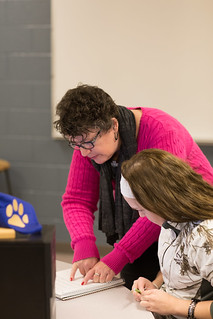 Sarah Bretches instructing student