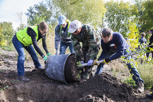 Volunteers with TreeUtah gathering to help plant trees